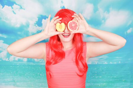 pretty bright woman with red grapefruit, the concept of summer and healthy nutrition
