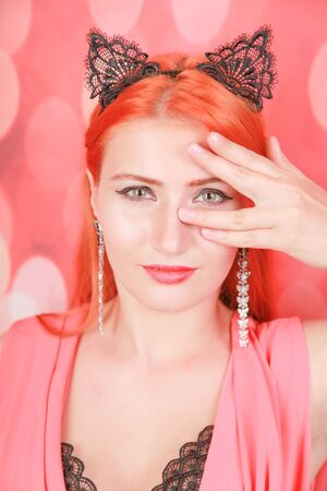Beautiful redheaded young girl with fashion lace cat ears on head