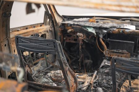 car after deliberate arson. destroyed vehicle after a fire melted is on the street. 스톡 콘텐츠