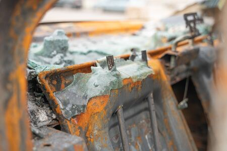car after deliberate arson. destroyed vehicle after a fire melted is on the street. Stock Photo