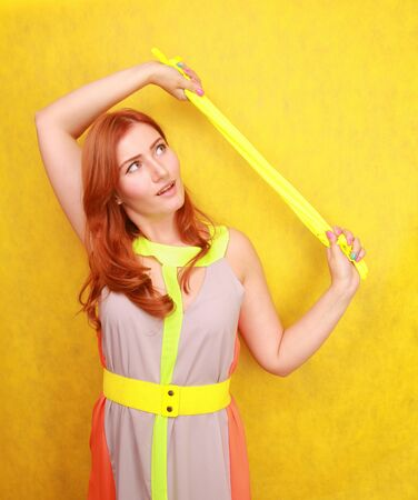 cute fashion lady with long satin fashion yellow gloves Stock fotó