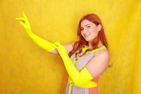 cute fashion lady with long satin fashion yellow gloves 스톡 콘텐츠