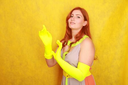 cute fashion lady with long satin fashion yellow gloves