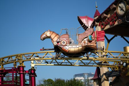 Amusement park rides with a very blue sky as background