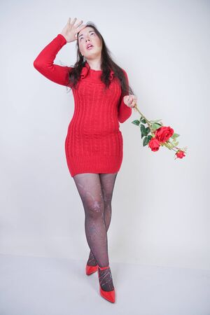 pretty mix raced plus size girl in elegant midi red dress hates flowers roses on white studio background