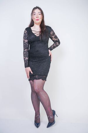 pretty mix raced plus size girl in elegant black lace midi dress on white studio background