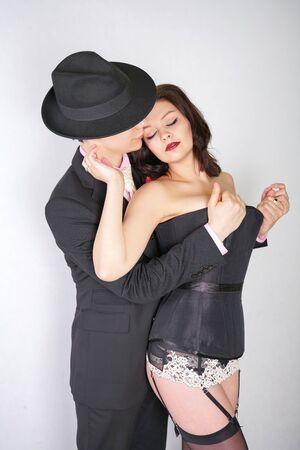 Happy couple in love hug each other on white studio background 版權商用圖片