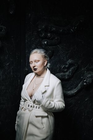portrait of unusual girl in white clothes on black background in the Studio. woman plus size albino. concept of beauty in any person Stock fotó