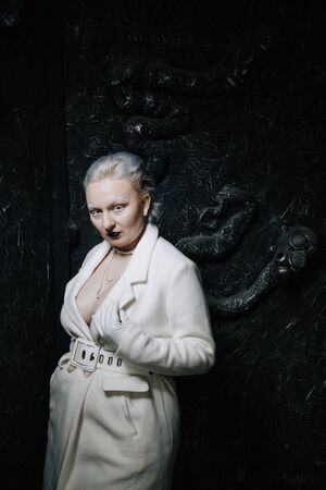 portrait of unusual girl in white clothes on black background in the Studio. woman plus size albino. concept of beauty in any person Reklamní fotografie