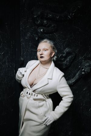 portrait of unusual girl in white clothes on black background in the Studio. woman plus size albino. concept of beauty in any person