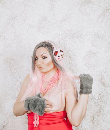 Portrait of a young beautiful woman in earmuffs on white background Zdjęcie Seryjne - 136810104
