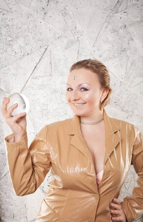 Pretty caucasian woman with her hands with crystal ball predicting the future on white background