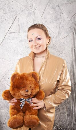 Beautiful plus size short hair woman with plush brown teddy bear