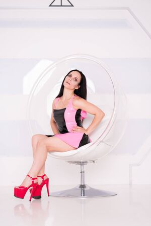 Photo of futuristic woman with black hair in white studio background