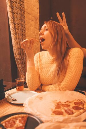 happy caucasian blonde plus size woman eating pizza end savoring with enjoy