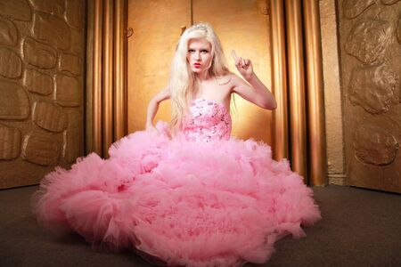Sexy slim blonde in fashion pink cloud dress with gorgeous long gown. Reklamní fotografie