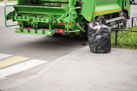 Garbage truck into waste emptying for waste disposal, Garbages creates environmental pollution