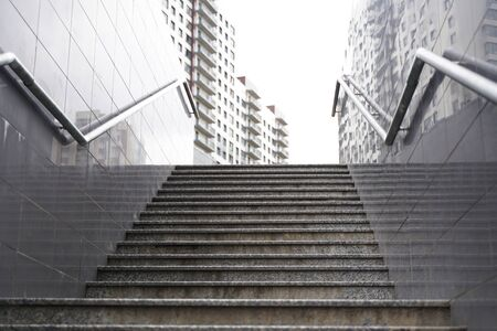 modern grey stone staircase in the city. nobody.