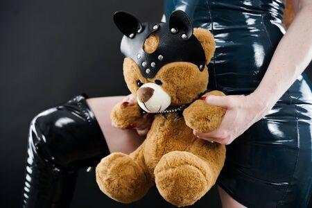 Bad Teddy Bear in leather harness with cat mask. Zdjęcie Seryjne