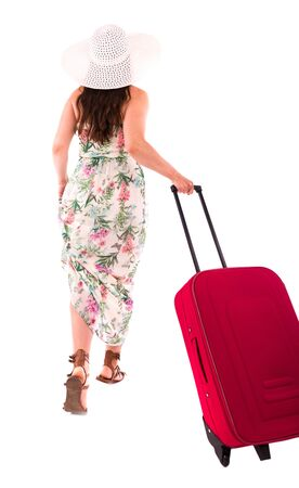 peers: A woman in a dress on a white background A red suitcase