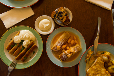 set of food dishes on a table in a cafe