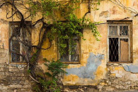 facade of an old building in the slums Stock Photo