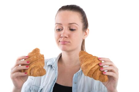 young girl with a croissant on a white background Stock Photo