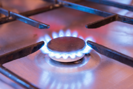 butane: burning gas ring stove on the stove