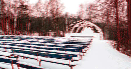 Park with a stage, benches, in the woods, winter, glitch effect. Imagens