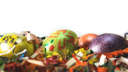 Colorful Easter eggs on stands, with paper decor of different colors. With free space. Banco de Imagens