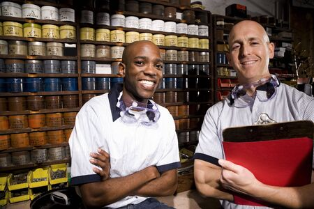 mature business man: Two male multiracial workers in a printing shot