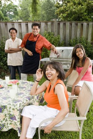 backyards: Interracial African American and Hispanic family having back yard barbecue