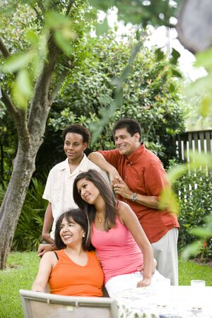 Interracial African American and Hispanic family together in back yard Stock Photo - 6178924