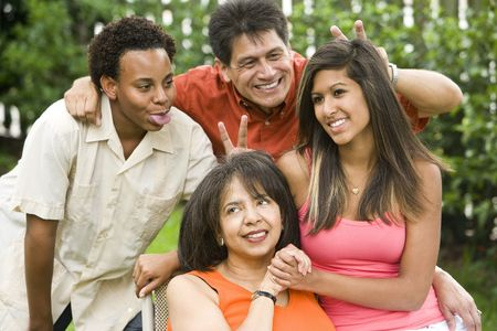 Interracial African American and Hispanic family portrait, making silly signs photo