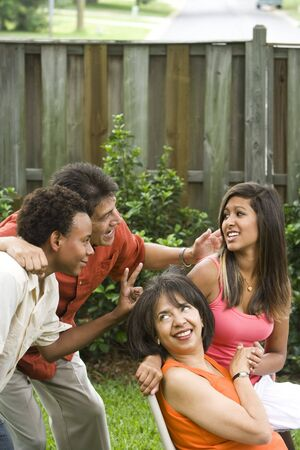 Interracial African American and Hispanic family portrait, acting silly for the camera photo