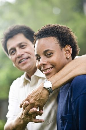 parent and teenager: Hispanic father with African American teenage son
