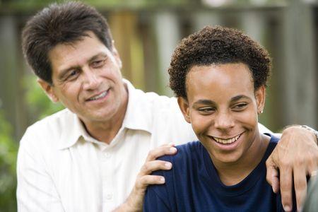 Hispanic father with African American teenage son photo