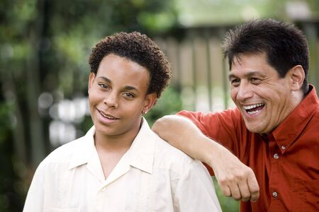 multiracial family: Hispanic father with African American teenage son