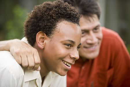 African American teenage boy with Hispanic father photo