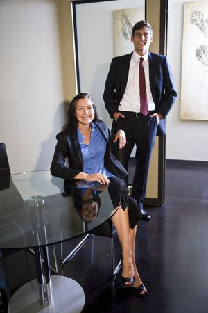 Portrait of young happy businessman and businesswoman in the office Stock Photo - 6189465