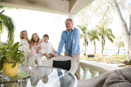Portrait of family on vacation relaxing on terrace together photo