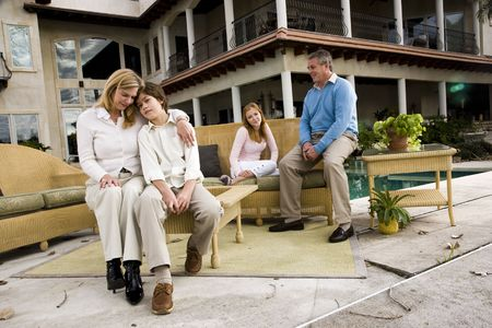 Family relaxing on patio together photo