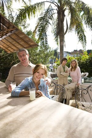 Portrait of family relaxing on outdoor patio photo