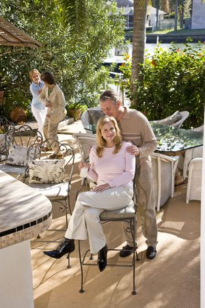 Portrait of family enjoying a sunny day outdoors on patio photo