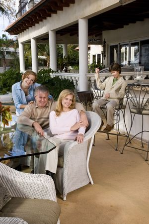 Portrait of carefree family relaxing on outdoor patio photo