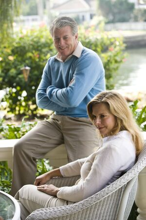 Mature couple relaxing on terrace photo