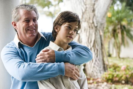 Affectionate father and son relaxing outdoors photo