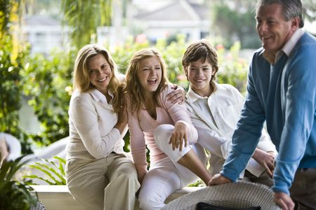 Portrait of family relaxing outdoors on porch together
