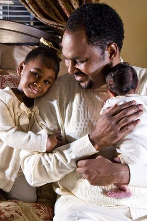 African American father with newborn son and four year old daughter Stock Photo