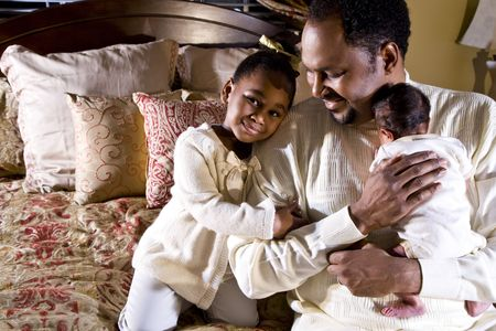 African American father with newborn son and four year old daughter photo